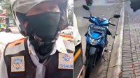 Screenshot rekaman video oknum petugas Dinas Perhubungan (Dishub) Kota Bekasi, Jawa Barat dan sepeda motor miliknya yang tanpa dilengkapi pelat nomor belakang (Dok. Instagram)