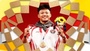 Lifter Rahmat Erwin Abdullah berhasil menyabet medali perunggu di Olimpiade Tokyo 2020 (Dok. Istimewa/setkab.go.id)